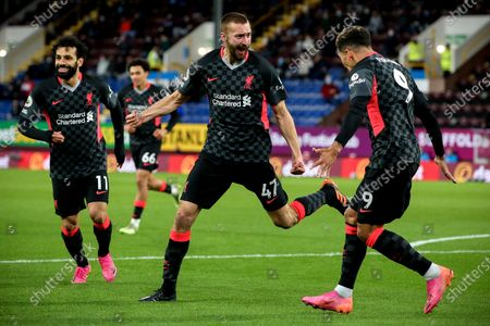 Liverpool's Nathaniel Phillips (C) celebrates with his teammate Roberto Firmino (R) after scoring the 2-0 lead during the English Premier League soccer match between Burnley FC and Liverpool FC in Burnley, Britain, 19 May 2021.