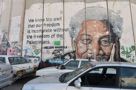 An image of actor Morgan Freeman accompanied by a quote by Nelson Mandela among other political and social mural paintings and graffitis on the wall separting Israel and the West Bank in Bethlehem. On Thursday, March 5, 2020, in Bethlehem, Palestine