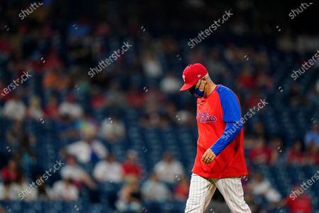 Philadelphia Phillies' Joe Girardi walks to the dugout during a baseball game against the Miami Marlins, in Philadelphia
