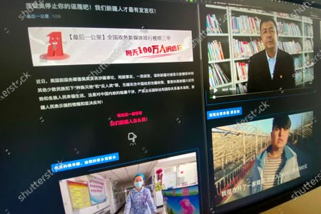 """Webpage with the title """"Pompeo stop your slanders! Only We Xinjiang people have a say!"""" and videos of ethnic Uyghurs responding to former U.S. Secretary of State Mike Pompeo is seen on a computer screen in Beijing on . China has highlighted an unlikely series of videos this year in which Uyghur men and women deny U.S. charges that Beijing is committing human rights violations against their ethnic group. In fact, a text obtained by the AP shows that the videos are part of a government campaign that raises questions about the willingness of those filmed"""