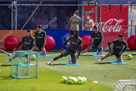 Atletico Madrid players (front row, L-R) Yannick Carrasco, Moussa Dembele, and Luis Suarez attend their team's training session at Sports City in Majadahonda, near Madrid, Spain, 20 May 2021. Atletico Madrid will face Real Valladolid in their Spanish La Liga soccer match on 22 May 2021 .