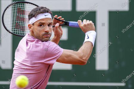 Grigor Dimitrov of Bulgaria in action against Pablo Cuevas from Uruguay during their quarter final match of the ATP 250 Tennis Geneva Open tournament in Geneva, Switzerland, 20 May 2021.