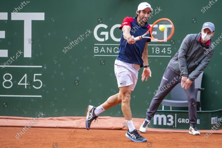Pablo Cuevas from Uruguay in action against Grigor Dimitrov of Bulgaria during their quarter final match of the ATP 250 Tennis Geneva Open tournament in Geneva, Switzerland, 20 May 2021.