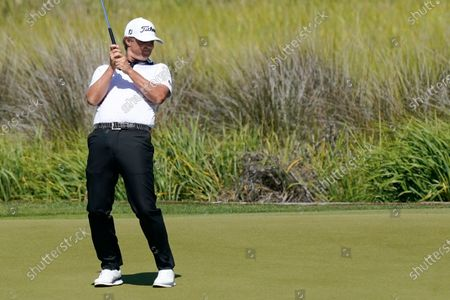 Matt Jones reacts to a putt on the 13th hole during the first round of the PGA Championship golf tournament on the Ocean Course, in Kiawah Island, S.C