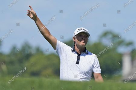 Matt Jones points out the direction of his shot on the 15th hole during the first round of the PGA Championship golf tournament on the Ocean Course, in Kiawah Island, S.C