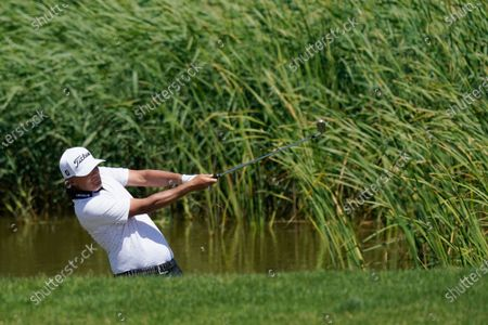 Matt Jones hits out of the rough on the 16th hole during the first round of the PGA Championship golf tournament on the Ocean Course, in Kiawah Island, S.C