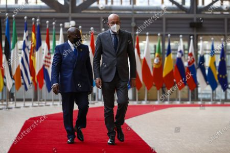 Ghana's President Nana Akufo-Addo, left, is welcomed by European Council President Charles Michel prior to their meeting at the European Council headquarters in Brussels