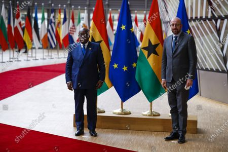 European Council President Charles Michel, right, and Ghana's President Nana Akufo-Addo pose for the media prior to their meeting at the European Council headquarters in Brussels