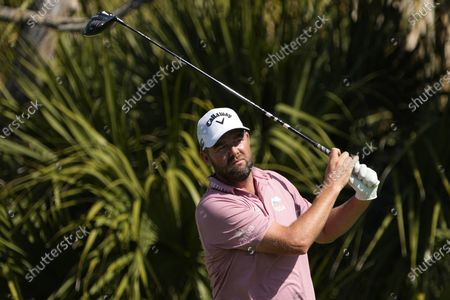 Marc Leishman, of Australia, watches his tee shot on the second tee during the first round of the PGA Championship golf tournament on the Ocean Course, in Kiawah Island, S.C