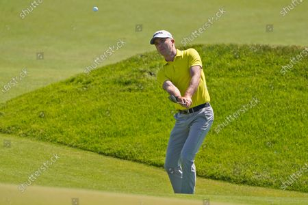 Martin Laird, of Scotland, watches his chip shot on the 11th hole during the first round of the PGA Championship golf tournament on the Ocean Course, in Kiawah Island, S.C