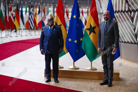 European Council President Charles Michel (R) and Ghana's President Nana Akufo-Addo pose for the media prior their meeting at the European Council headquarters in Brussels, Belgium, 20 May 2021.