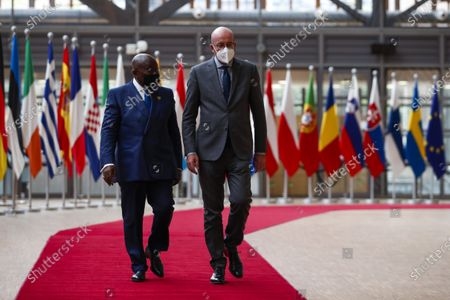 Ghana's President Nana Akufo-Addo (L) is welcomed by European Council President Charles Michel prior their meeting at the European Council headquarters in Brussels, Belgium, 20 May 2021.