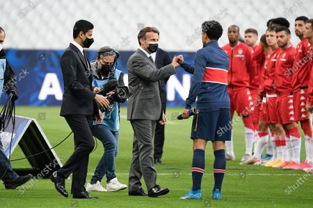 Nasser Al Khelaifi, French President Emmanuel Macron and Marquinhos before the French Cup final soccer match between Paris Saint Germain and Monaco at the Stade de France stadium, in Saint Denis, north of Paris, Wednesday, May 19, 2021.