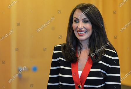 Stock Picture of Molly Bloom, an American entrepreneur, former Poker Princess and bestselling author Of Molly's Game, poses for a selfie at Pendulum Summit, World's Leading Business and Self-Empowerment Summit, in Dublin Convention Center. On 8 January 2020, in Dublin, Ireland.