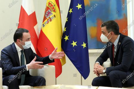 Spanish Prime Minister Pedro Sanchez (R) and his Georgian counterpart Irakli Garibashvili (L) talk during their bilateral meeting at Moncloa Palace in Madrid, Spain, 20 May 2021.