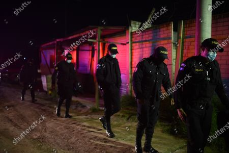 Stock Photo of Members of the police are seen during the transfer of the bodies of the seven murdered inmates 19 May, in a jail in western Guatemala in the municipality of Cantel, Guatemala, 19 May 2021 (Issued 20 May 2021). At least seven inmates were beheaded on 19 May in a riot in a jail in western Guatemala, according to police sources. The massacre took place around 4:00 p.m. local time (22:00 GMT) at the Model Rehabilitation Farm in the municipality of Cantel, in the department of Quetzaltenango, some 200 kilometers west of Guatemala City. The deceased inmates according to the Penitentiary System are Edvin Guerra Pina, Melvin Cabrera Molina, Victor Ventura Isem, Adrian Garcia Fuentes, Manuel Sosa Matul, Edgar Marquez Siguenza and Melvin Hernandez.