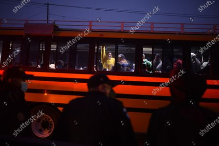 Stock Image of Inmates are transferred at dawn after a riot that left seven inmates murdered in a jail in western Guatemala in the municipality of Cantel, Guatemala, 20 May 2021. At least seven inmates were beheaded on 19 May in a riot in a jail in western Guatemala, according to police sources. The massacre took place around 4:00 p.m. local time (22:00 GMT) at the Model Rehabilitation Farm in the municipality of Cantel, in the department of Quetzaltenango, some 200 kilometers west of Guatemala City. The deceased inmates according to the Penitentiary System are Edvin Guerra Pina, Melvin Cabrera Molina, Victor Ventura Isem, Adrian Garcia Fuentes, Manuel Sosa Matul, Edgar Marquez Siguenza and Melvin Hernandez.