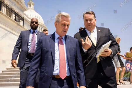 Stock Image of Republican House Minority Leader Kevin McCarthy (C) speaks with Republican Representative from West Virginia Alex Mooney (R) ahead of an event to mark Cuban Independence Day outside the US Capitol in Washington, DC, USA, 20 May 2021.