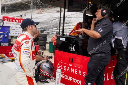 Marco Andretti, left, talks with his father and car owner Michael Andretti during practice for the Indianapolis 500 auto race at Indianapolis Motor Speedway in Indianapolis