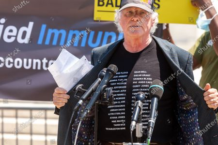Ben Cohen, co-founder of Ben & Jerry's Ice Cream, displays his shirt while speaking at an event urging an end to qualified immunity for police.  His shirt contains the names of many Black individuals killed by police whose families were denied justice and restitution because of qualiied immunity laws.