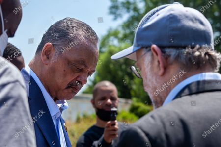 Rev. Jesse Jackson (left) speaks with Jerry Greenfield (right), co-founder of Ben and Jerry's Ice Cream, during his surprise visit to an event urging an end to qualified immunity for police.