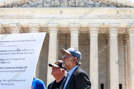 Ben Cohen (left) and Jerry Greenfield (right), co-founders of Ben & Jerry's Ice Cream, host an event at the US Supreme Court urging an end to qualified immunity for police.