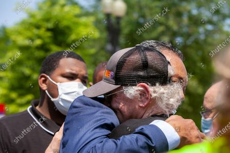 Ben Cohen, co-founder of Ben & Jerry's Ice Cream, greets Reverend Jesse Jackson with a hug during an event at the US Supreme Court urging an end to qualified immunity for police.