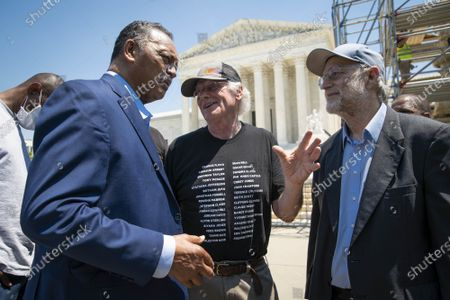"""Ben Cohen, center, and Jerry Greenfield, right, co-founders of Ben & Jerry's Ice Cream, speak with Reverend Jesse L. Jackson outside of the Supreme Court of the United States on Capitol Hill in Washington, DC on Thursday, May 20, 2021. Cohen and Greenfield held a news conference to give out ice cream and """"demand Congress pass meaningful police reform and end qualified immunity."""""""