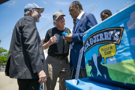 """Jerry Greenfield, left, and Ben Cohen, center, co-founders of Ben & Jerry's Ice Cream, speak with Reverend Jesse L. Jackson outside of the Supreme Court of the United States on Capitol Hill in Washington, DC on Thursday, May 20, 2021. Cohen and Greenfield held a news conference to give out ice cream and """"demand Congress pass meaningful police reform and end qualified immunity."""""""