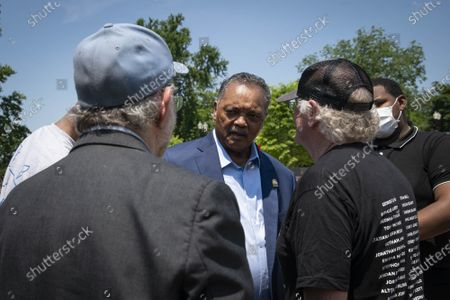 """Jerry Greenfield, left, and Ben Cohen, right, co-founders of Ben & Jerry's Ice Cream, speak with Reverend Jesse L. Jackson outside of the Supreme Court of the United States on Capitol Hill in Washington, DC on Thursday, May 20, 2021. Cohen and Greenfield held a news conference to give out ice cream and """"demand Congress pass meaningful police reform and end qualified immunity."""""""