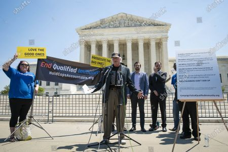 """Ben Cohen, co-founder of Ben & Jerry's Ice Cream, speaks during a news conference outside of the Supreme Court of the United States on Capitol Hill in Washington, DC on Thursday, May 20, 2021. Cohen and Jerry Greenfield held an event to give out ice cream and """"demand Congress pass meaningful police reform and end qualified immunity."""""""