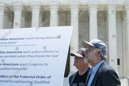 """Ben Cohen, left, and Jerry Greenfield, right, co-founders of Ben & Jerry's Ice Cream, listen during a news conference outside of the Supreme Court of the United States on Capitol Hill in Washington, DC on Thursday, May 20, 2021. Cohen and Greenfield held an event to give out ice cream and """"demand Congress pass meaningful police reform and end qualified immunity."""""""
