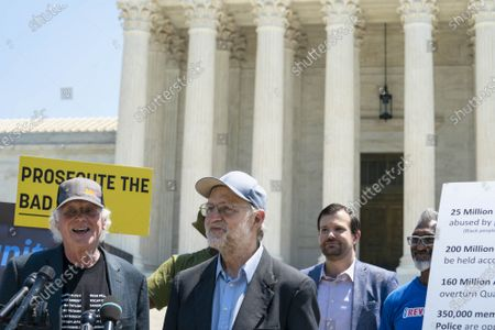 """Ben Cohen, left, and Jerry Greenfield, right, co-founders of Ben & Jerry's Ice Cream, speak during a news conference outside of the Supreme Court of the United States on Capitol Hill in Washington, DC on Thursday, May 20, 2021. Cohen and Greenfield held an event to give out ice cream and """"demand Congress pass meaningful police reform and end qualified immunity."""""""