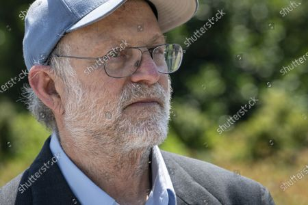 """Jerry Greenfield, co-founder of Ben & Jerry's Ice Cream, listens during an event outside of the Supreme Court of the United States on Capitol Hill in Washington, DC on Thursday, May 20, 2021. Greenfield and Ben Cohen held a news conference to give out ice cream and """"demand Congress pass meaningful police reform and end qualified immunity."""""""