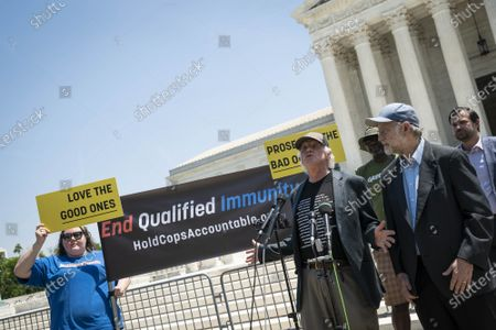 """Ben Cohen, left, and Jerry Greenfield, right, co-founders of Ben & Jerry's Ice Cream, speak at a news conference outside of the Supreme Court of the United States on Capitol Hill in Washington, DC on Thursday, May 20, 2021. Cohen and Greenfield held an event to give out ice cream and """"demand Congress pass meaningful police reform and end qualified immunity."""""""
