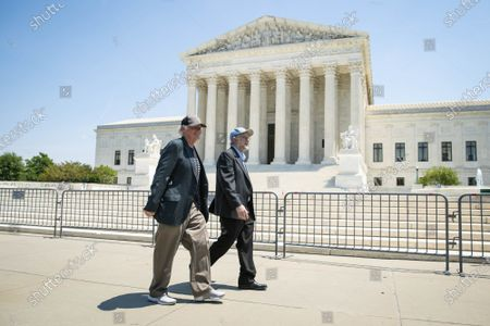 """Stock Image of Ben Cohen, left, and Jerry Greenfield, right, co-founders of Ben & Jerry's Ice Cream, walk past the Supreme Court of the United States after a news conference on Capitol Hill in Washington, DC on Thursday, May 20, 2021. Cohen and Greenfield held an event to give out ice cream and """"demand Congress pass meaningful police reform and end qualified immunity."""""""