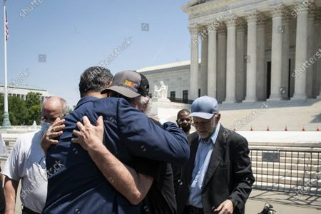 """Stock Picture of Ben Cohen, co-founder of Ben & Jerry's Ice Cream, hugs Reverend Jesse L. Jackson outside of the Supreme Court of the United States on Capitol Hill in Washington, DC on Thursday, May 20, 2021. Cohen and Jerry Greenfield held a news conference to give out ice cream and """"demand Congress pass meaningful police reform and end qualified immunity."""""""