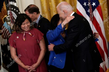 US President Joe Biden hugs Senator Mazie Hirono (D-HI) before signing the COVID-19 Hate Crimes Act into law in the East Room at the White House in Washington, DC, USA, 20 May 2021.