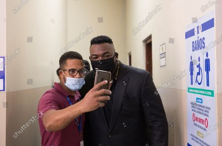 Former Dominican baseball player David 'Big Papi' Ortiz, legend of the Boston Red Sox, poses for a picture with a fan as he attends a hearing at the National District Court of Appeal, in Santo Domingo, Dominican Republic, 20 May 2021. Ortiz's lawyers on 20 May filed an appeal filed against the decision of the Fifth Investigating Court to continue with the case of domestic violence and violence against women allegedly committed against his former partner Fary Almanzar.