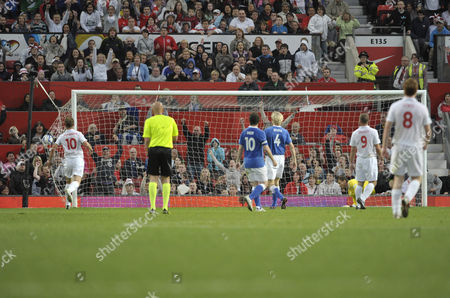 Stock Image of Teddy Sheringham, Alan Shearer, Michael Sheen and Sami Hypia look on as the celebrity England side score