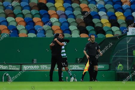 Stock Image of Ruben Amorim of Sporting CP Hug Joao Pereira of Sporting CP for is last career  match during the Liga NOS match between Sporting CP and CS Maritimo at Estadio Jose Alvalade on May 19, 2021 in Lisbon, Portugal.