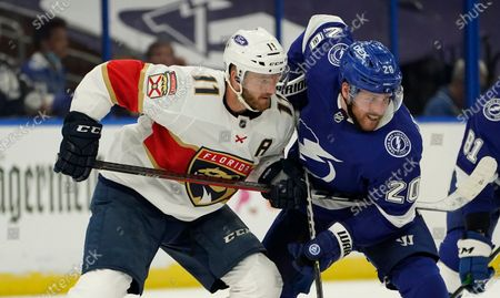 Stock Picture of Florida Panthers left wing Jonathan Huberdeau (11) battles with Tampa Bay Lightning center Blake Coleman (20) during the second period in Game 3 of an NHL hockey Stanley Cup first-round playoff series, in Tampa, Fla