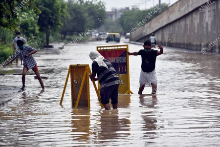 MCG workers pumping water out of a waterlogged stretch, near Subhash Chowk, on May 20, 2021 in Gurugram, India. Gurugram on Wednesday night witnessed record rainfall under the impact of Cyclone Tauktae. The heavy downpour led to waterlogging in several parts of the city.