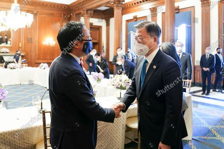 South Korean President Moon Jae-in (R) shakes hands with US congressman Andy Kim, a Korean-American Democrat, after holding talks with US House of Representatives Speaker Nancy Pelosi and other congressional leaders on Capitol Hill in Washington, DC, USA, on 20 May 2021.