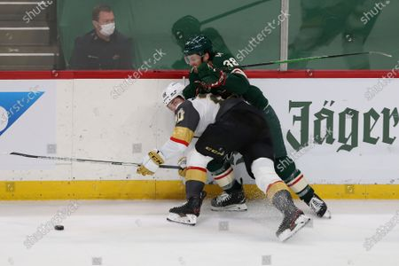 Stock Image of Vegas Golden Knights' Chandler Stephenson (20) and Minnesota Wild's Ryan Hartman (38) go after the puck during the third period in Game 3 of a first-round NHL hockey playoff series, in St. Paul, Minn. The Golden Knights won 5-2