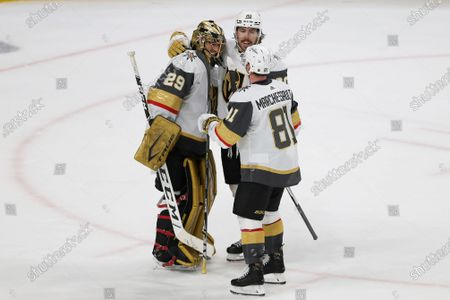 Vegas Golden Knights goalie Marc-Andre Fleury (29) celebrates with Chandler Stephenson (20) and Jonathan Marchessault (81) after the team's 5-2 win over the Minnesota Wild in Game 3 of a first-round NHL hockey playoff series, in St. Paul, Minn