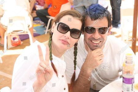 Stock Picture of Geena Davis and husband Dr. Reza Jarrahy