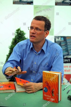 Yann Martel signing copies of his book