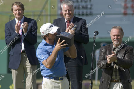 Tournament winner Graeme McDowell of Northern Ireland with Sir Terry Matthews (right)