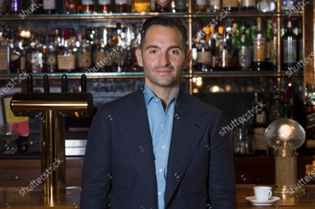 Stock Image of Chef Mario Carbone poses for a photo at Carbone, in Miami Beach, Fla